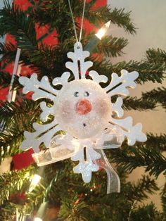 Snowman ornament. Made from dollar store snowflake and a cut in half styrofoam ball painted like a snowman. Christmas 2008
