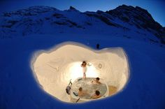 Jacuzzi at Iglu-Dorf resorts, Switzerland, a community of beautifully carved igloos, virtually everything made of pure white snow.