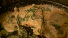 "Creamy Spinach Salmon - stir to combine spinach (fresh or frozen), 2 c. cream or half & half, 3 tbsp soy sauce, 2 tsp Dijon mustard, 1/2 tsp ground nutmeg and salt & pepper to taste to a 12"" nonstick skillet. Place salmon atop mixture, skin side down. Cook for 20 min at slow simmer. Periodically spoon sauce over fish while cooking. Mix tbsp of corn starch & tbsp water. Stir into sauce to thicken and cook another 5-10 min depending on thickness of salmon. Really tasty!"
