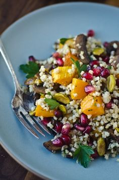 Millet pilaf with roasted butternut squash, mushrooms and pomegranate