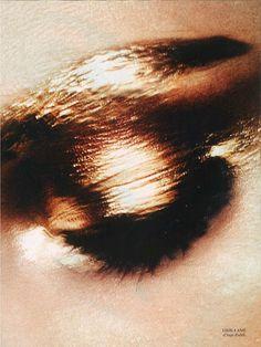 Metallic eyes.
