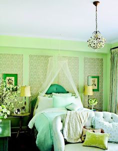 This bedroom uses a lot of different shades and tints of greens.