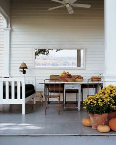 """The front porch is decorated with strategically placed mirror """"landscapes""""."""