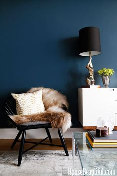 Dumont Media Cabinet + Modern Windsor Accent Chair from west elm via Sheena Murphy Apartment - Designers at Home - House Beautiful