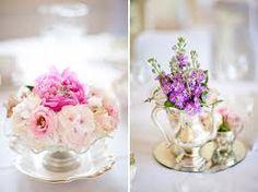 Silver tea set pieces are repurposed as gorgeous vases.