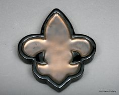 Saints fleur de lis spoon rest in black and gold, Hurricanepottery.etsy.com