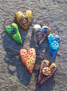 Clay hearts with wire wings.  Use rebar wire?