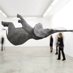 """French artist Daniel Firman has taken the saying """"elephant in the room"""" to another level."""