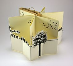 """Artist book """"Among Humans""""  Edition of two artist books  inspired on the theme of freedom. Lino-cut prints on paper and wood applications."""