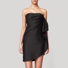 Black wrap strapless dress with accentuated draping side detail. Sleeveless with fitted bodice and hidden zip fastening at back. Hemline follows wrap and lifts on one side into tie feature. Sleek evening dress for any occasion.This may be purchased on ecofirstart.com