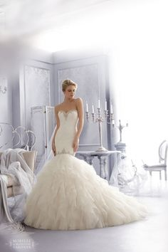 Fall 2014 Mori Lee - Memphis. Crystal Beading Trims Alencon Lace with Laser Cut Organza Ruffles.