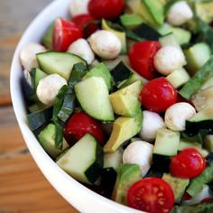 Cool Off With Our 250-Calorie Cucumber Avocado Caprese Salad: If your garden (or farmers market) is overflowing with fresh cucumbers, tomatoes, and basil, it's salad-making time!