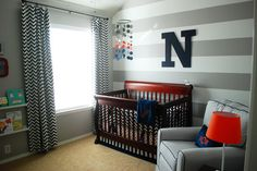 This gray, white and navy nursery is 100% boy! We love the classic look with trendy touches. #nursery #babyboy