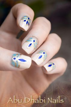Abu Dhabi inspired nails - blue and gold nails. Click for manicure details.