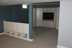 Leesburg Finished Basement 2 with a nice built in seat and storage area and built in entertainment center