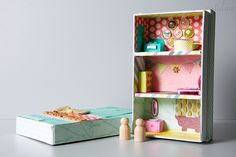 Adorable mini doll house made from #DearLizzy paper and embellishments