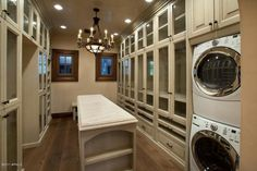 OMG; washing machine in the walk in closet. GENIUS! And the see through cabinets are amazing!