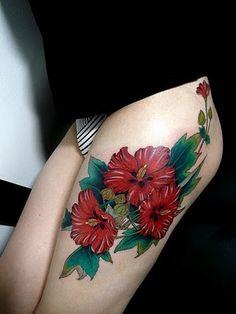 tattoo ideas, thigh tattoos, feet tattoos, color, red flowers, leg tattoos, flower tattoos, floral tattoos, tattoo ink
