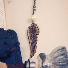 Brass Wing and Pearl Necklace by violetbella on Etsy,