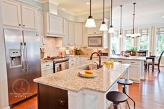 i love this kitchen- white cabinets granite counterswood floor