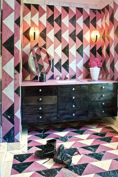 Powder room with wall-to-floor tile patterns.