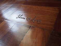 carve names into wood floor of house built together.