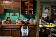 Three-year-old C. J. Shot bathes among dishes. The Oglala concept of tiospaye 'the unity of the extended family' means that homes are often overcrowded, especially with the severe housing shortage on the reservation    Read more: http://www.dailymail.co.uk/news/article-2182898/In-shadow-Wounded-Knee-Inside-Pine-Ridge-reservation-South-Dakota.html#ixzz22UfwxliV