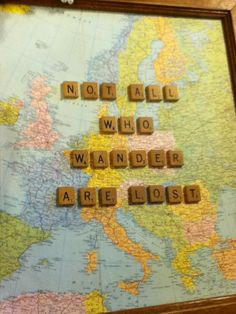 picture frame of old map w/ scrabble pieces.