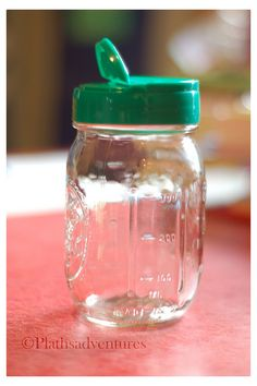 A parmesan cheese lid fits a regular mouth Mason jar perfectly...use in craft room