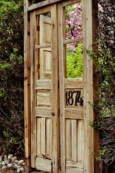 repurposed door for garden gate.... charming!