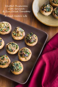 Spinach and sun-dried tomato stuffed mushrooms. Great appetizer to keep growling stomachs happy while dinner is getting ready.