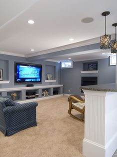 What about this configuration with t.v. On one wall and f.p on another with bar in back?