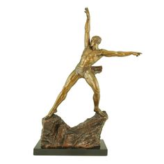 Art Deco bronze by Pierre Le Faguays. >>> France.  1925  Art Deco bronze of an athletic man standing on a rock signed by Pierre Le Faguays.  On a black marble base.