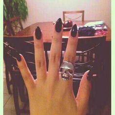 Stilleto nails and skull ring