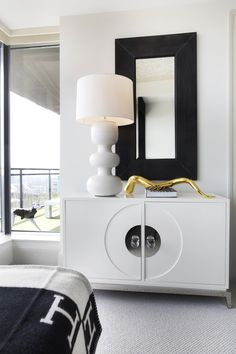 Hollywood Regency Furniture - A mod white lamp atop a white credenza