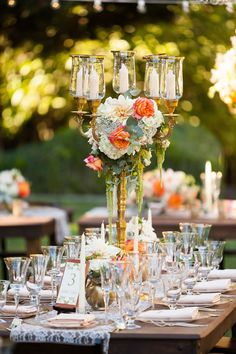 Hanging amaranthus, hydrangea, dahlia, and ranunculas spill out from a tall candelabra. Shelli Armstrong Events and Design.