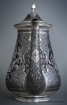 finely engraved spout