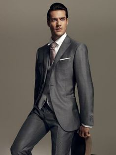 Straight morning suit in wool and silk with a shiny micro effect. Two button jacket, silver grey with pearl grey waistcoat. Striped trousers without pleats, 20 cm base. #formalwear13 #men