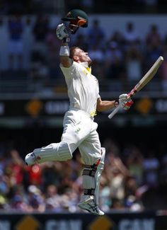 Australia's David Warner celebrates his century during the third day's play of the first Ashes cricket test match against England in Brisbane November 23, 2013.