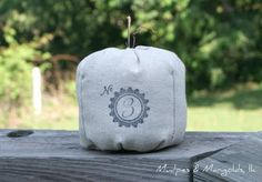 What a great idea! Pumpkin table number markers.