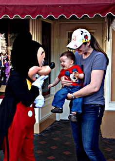 My baby cousin was soooo excited to meet Mickey Mouse. :3