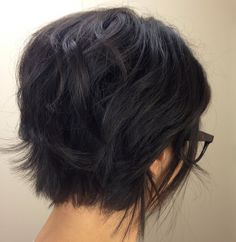 back.  getting my hair cut like this! next week!