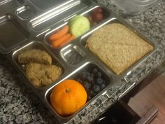 Homemade almond choc. chip cookie, clementine, blueberries, carrots, cucumbers, grapes, and a PBJ on Ezekiel Bread!