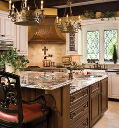 "crown lighting, copper hood, granite,  and varying levels ""eat in"" island..."