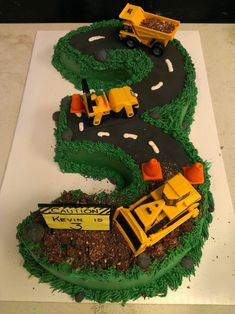 What a cool idea for a 3rd Birthday Cake! Who doesn't love trucks!