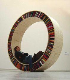 This. But in front of a big circular window. circular bookshelf, bookcases, wheel, art, book storage, librari, shelv, chuck palahniuk, innovative design