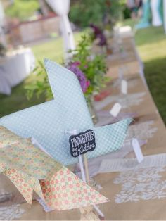 chalkboard signs on a stick // View more: http://ruffledblog.com/community/recycle-your-wedding-browse/reception/4-chalkboard-signs-on-a-stick-10706.html chalkboard signs, kite, pinwheel
