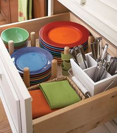 Yes, why do I keep my dishes, flatwear and napkins in different locations?    Dish Drawer -  Instead of lifting plates high onto upper cabinets, keep them low. Keeping silverware, napkin rings, and cloth napkins in the same drawer makes table setting a snap.