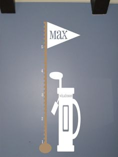A cute way to measure your child's growth in this golf themed room // Pipeline Marketing