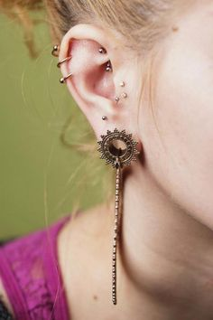 """""""Rose gold twister from BVLA in helix, rook piercing using Industrial Strength curved barbell, genuine diamonds from BVLA in tragus, anti-tragus piercing with Neometal jewelry and Tawapa rose gold plated Afghan Hoops and eyelets, all in Anna's ears."""""""
